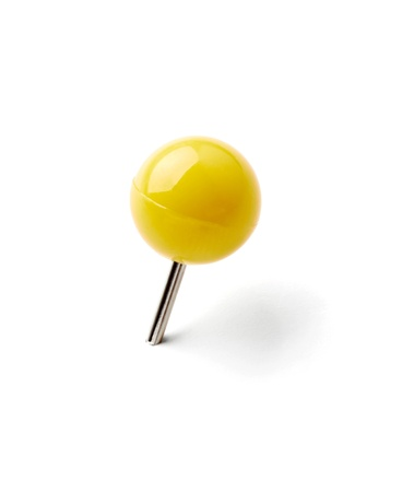 yellow tacks: close up of a pushpin on white background with clipping path