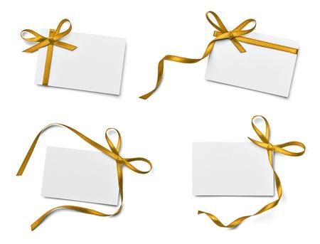 白い背景の上のリボンの弓を持つ様々 なノート カードのコレクションです。それぞれは別々 に撮影します。 写真素材