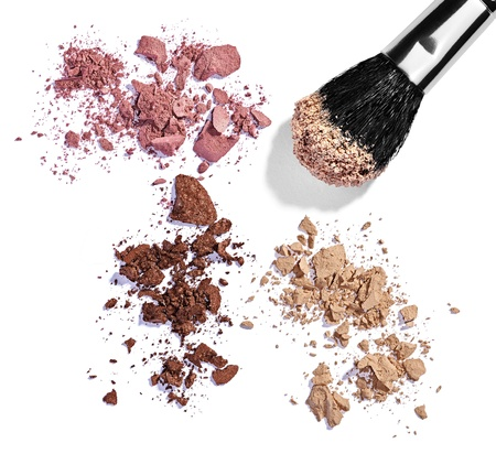 close up of  a make up powder and a brush on white background Stock Photo