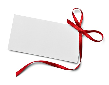 christmas tag: close up of a  note card with ribbon bow on white background