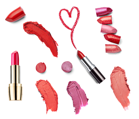 collection of  various lipsticks  and heart shapes on white background  photo