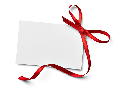 christmas banner: close up of a  note card with ribbon bow on white background