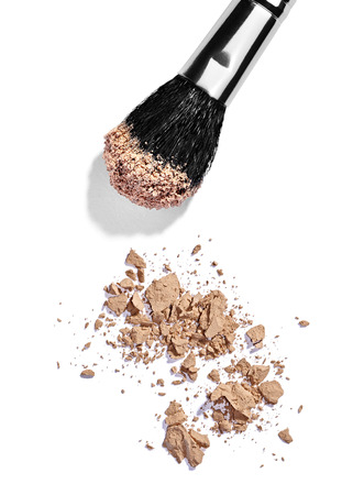 close up of  a make up powder and a brush on white  Stock Photo