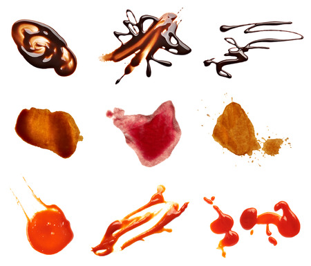 wine sauce: collection of various coffee, wine, ketchup and chocolate stains on white each one is shot separately Stock Photo