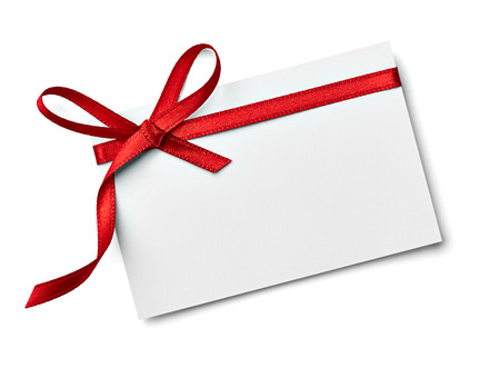 blank tag: close up of a  note card with ribbon bow on white background