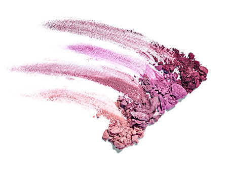 close up of  a make up powder and a brush on white background photo