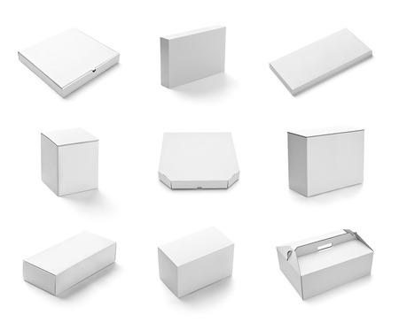 caja de pizza: colecci�n de varia caja blanca y paquetes en el fondo blanco cada una se dispara por separado Foto de archivo
