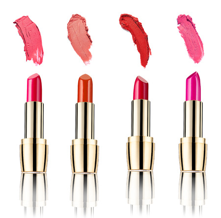 collection of various lipstick and nail polish strokes on white background  each one is shot separately photo