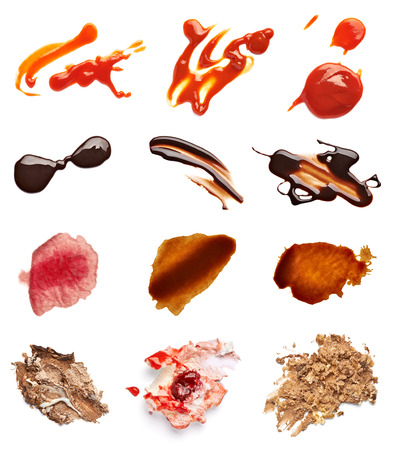 wine sauce: collection of various coffee, wine, ketchup, chocolate and cake stains on white background  each one is shot separately
