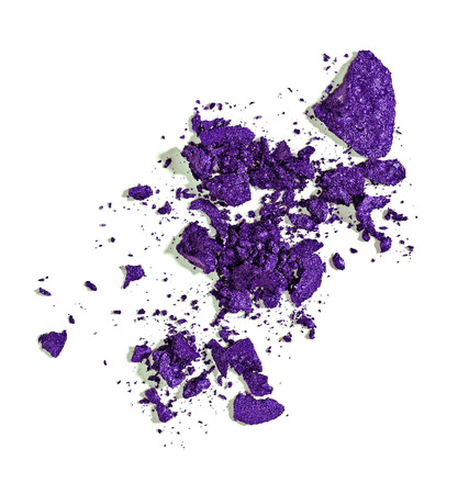 crushed by: close up of  a make up powder and a brush on white background Stock Photo