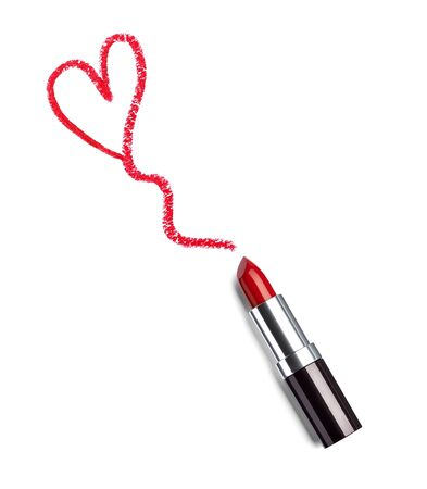 close up of  a lipstick and a heart shape on white background photo