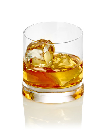 whisky glass: close up of  a whiskey with ice cubes on white background Stock Photo