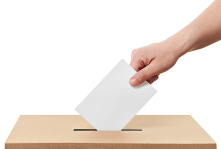 close up of  a ballot box and casting vote on white background Banco de Imagens - 27984328