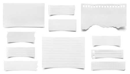 collection of various pieces of note paper on white background  each one is shot separately photo