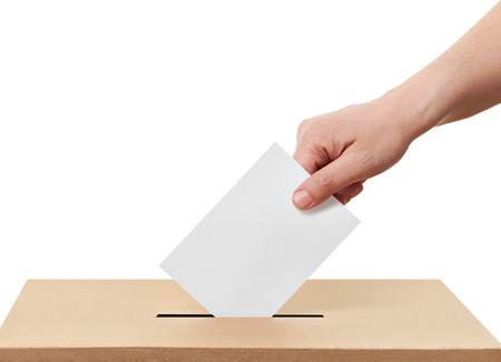 voter: close up of  a ballot box and casting vote on white background