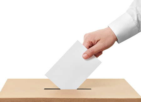 balloting: close up of  a ballot box and casting vote on white background