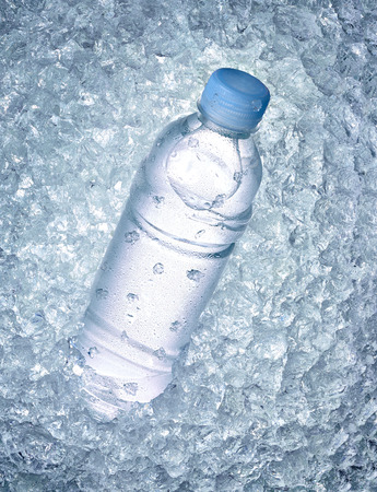 water cooler: close up of a water bottle in ice Stock Photo