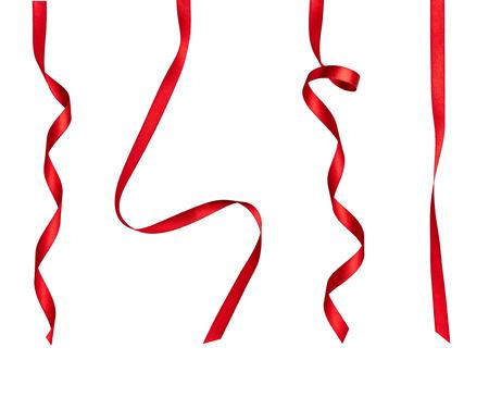 白い背景にさまざまな赤いリボンのコレクションそれぞれ別々 にショットです。 写真素材