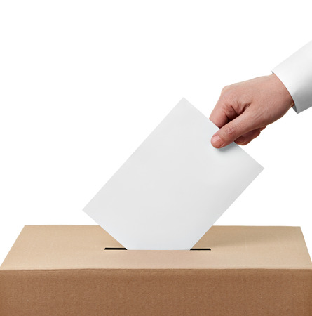 ballot papers: close up of  a ballot box and casting vote on white background