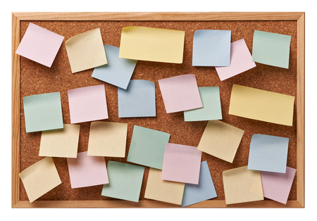 close up of note papers on a corkboard photo