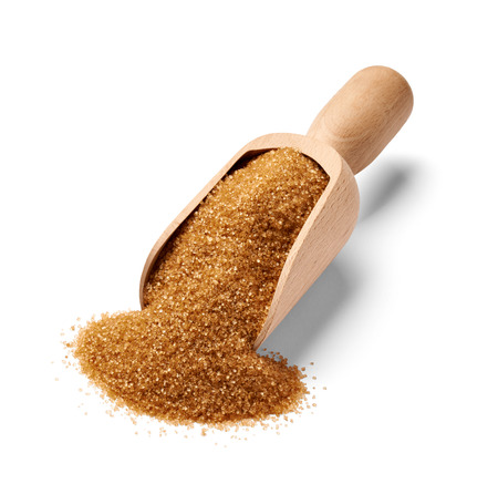 granulated: close up of  brown sugar on white background Stock Photo
