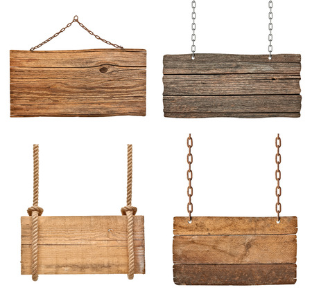 collection of various empty wooden signs hanging on a rope and chain on white background  each one is shot separately photo