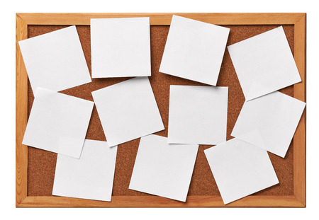 cork board: close up of note papers on a corkboard