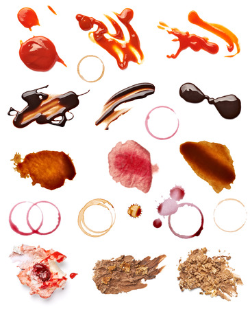 collection of various coffee, wine, ketchup, chocolate and cake stains on white background  each one is shot separately