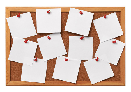 corkboard: close up of note papers on a corkboard