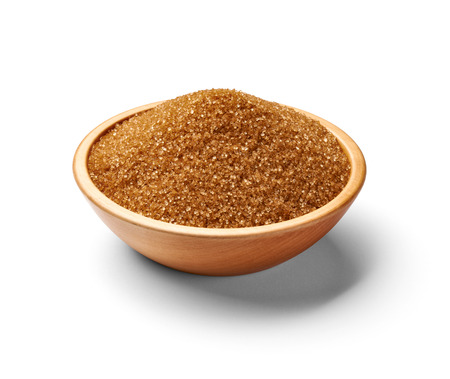 crystal bowl: close up of  brown sugar on white background Stock Photo