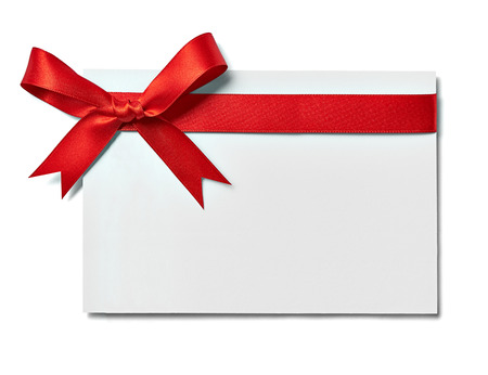 gift tag: close up of a note card with ribbon bow on white background