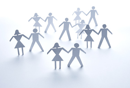 close up of  paper people on white background photo