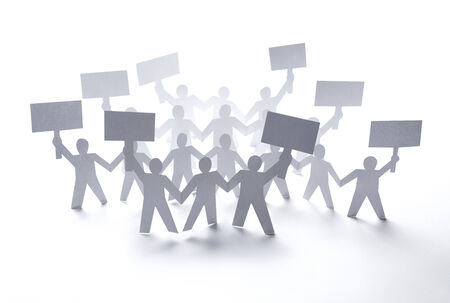 close up of  paper people rally on white background photo