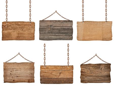 signos de precaucion: colecci�n de varios signos de madera con cadena sobre fondo blanco. cada uno es disparado por separado