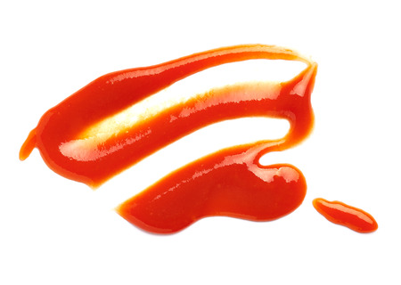 tomato catsup: close up of  a ketchup stain on white background