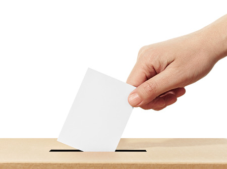 inserting: close up of  a ballot box and casting vote on white background