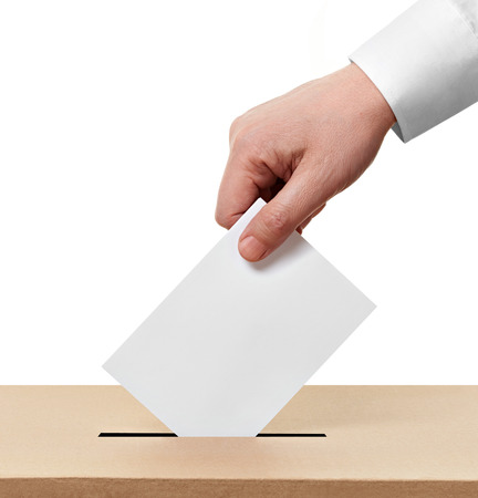 voting ballot: close up of  a ballot box and casting vote on white background