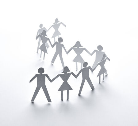 family unity: close up of  paper people couple on white background