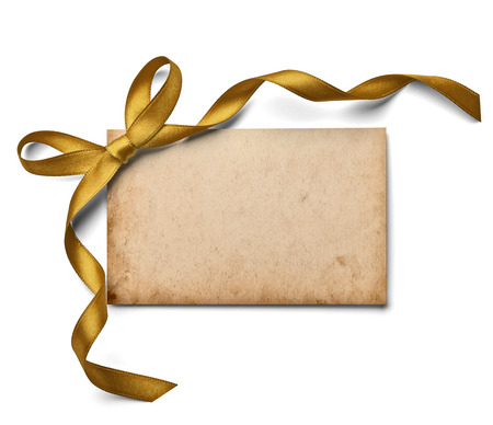 old envelope: close up of a  note card with ribbon bow on white background