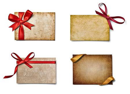 collection of various note cards with ribbon bow on white background. each one is shot separately photo