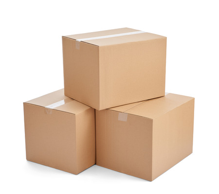 boxes: close up of  a stack of cardboard boxes on white background Stock Photo