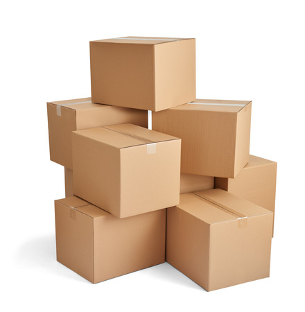 close up of  a stack of cardboard boxes on white background Banco de Imagens