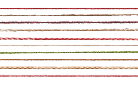 yarn: collection of  various strings on white background. each one is shot separately