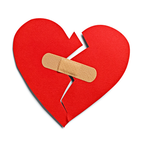 a wound: close up of a heart shape with bandage on white background