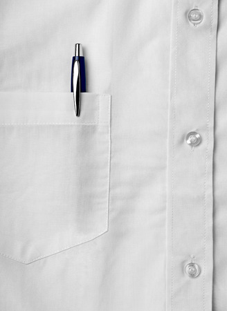 close up of a white shirt with a pen 스톡 콘텐츠