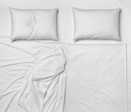 bed sheets: studio shot of bedding sheets and pillows Stock Photo