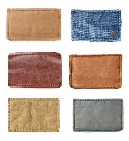 worn jeans: collection of various  jeans labels on white background. each one is shot separately. Stock Photo