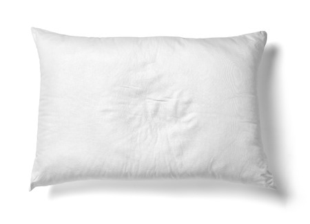 bed sheet: close up of  a white pillow on white background
