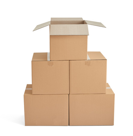 karton: close up of a stack of cardboard boxes on white background