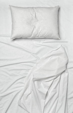 bed sheet: studio shot of bedding sheets and pillows Stock Photo